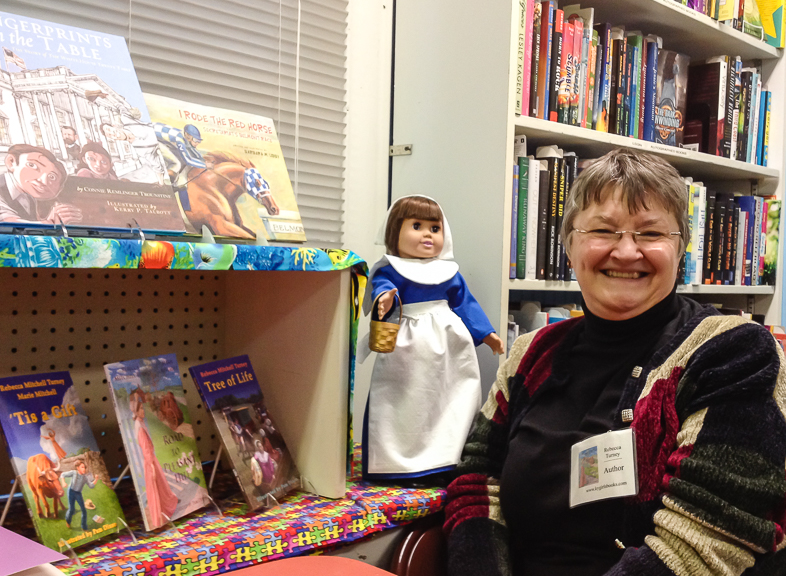 Rebecca with doll and books